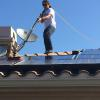 Solar panel cleaning on a two story house